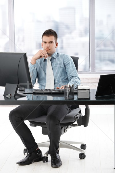Young manager sitting in modern office Stock photo © nyul