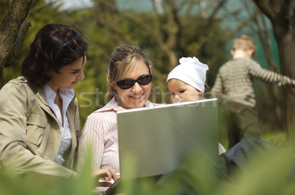 Mothers are using laptop Stock photo © nyul