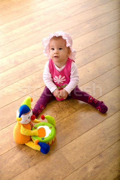 Baby and toy clown Stock photo © nyul