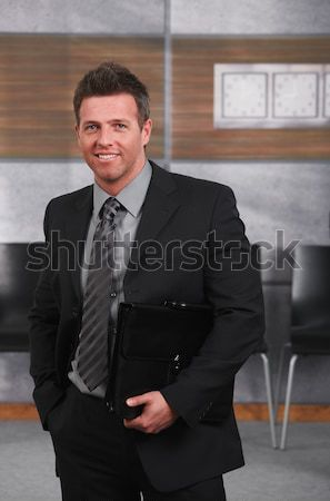 Portrait of smiling businessman Stock photo © nyul