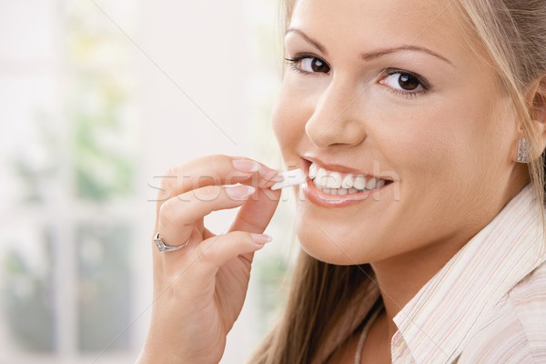 Beautiful woman eating chewing gum Stock photo © nyul