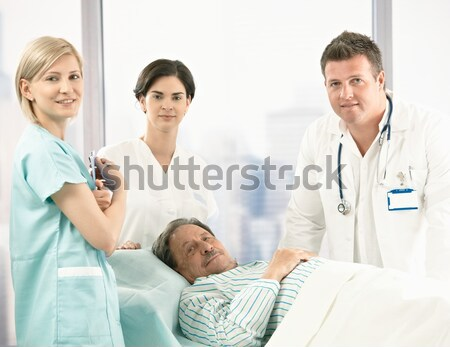Doctors and nurse with older patient Stock photo © nyul