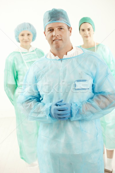 Doctor and two assistant in scrubs Stock photo © nyul