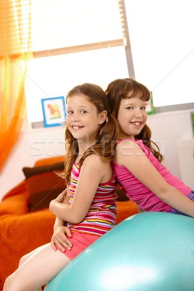 Fiatal lányok ül testmozgás labda együtt Stock fotó © nyul