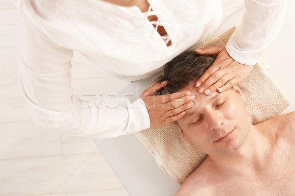 Stock photo: Man getting relaxing head massage