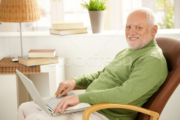 Stock photo: Portrait of aged man with laptop