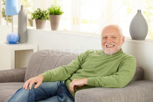 Portrait of happy senior on sofa Stock photo © nyul