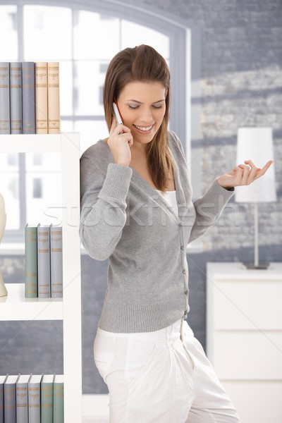 Cheerful woman on phone call at home Stock photo © nyul