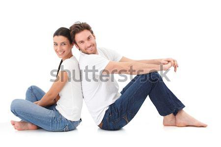 Derűs pár mosolyog boldogan fiatal pér ül Stock fotó © nyul