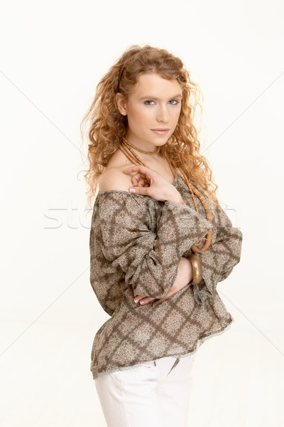 Pretty girl with long curly hair looking at camera Stock photo © nyul