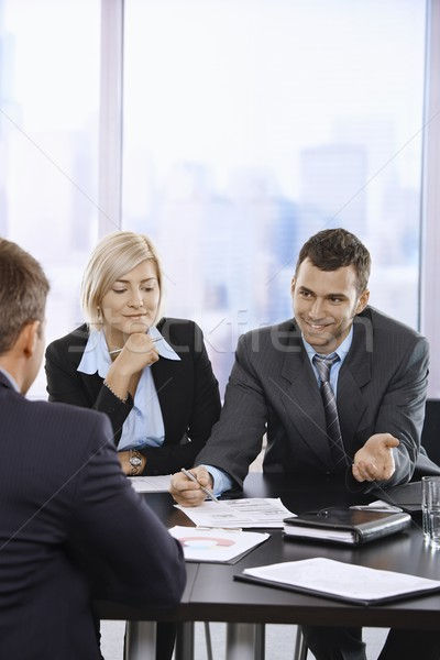 Uomini d'affari parlando riunione sorridere ufficio business Foto d'archivio © nyul