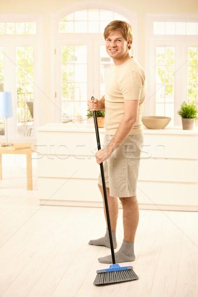 Guy sweeping the floor Stock photo © nyul