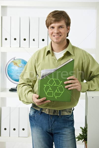Young man holding green folder Stock photo © nyul