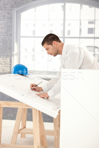 Young architect drawing plans Stock photo © nyul