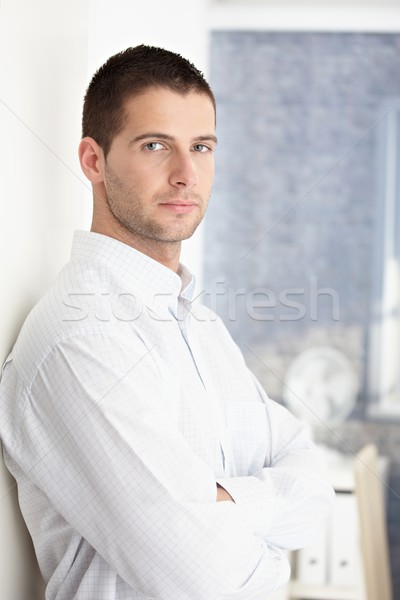 Goodlooking man standing arms crossed Stock photo © nyul