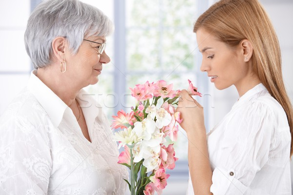 Senior mother and daughter with flowers Stock photo © nyul