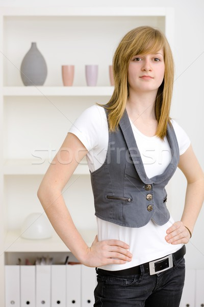 Menina adolescente posando mãos quadril casa Foto stock © nyul