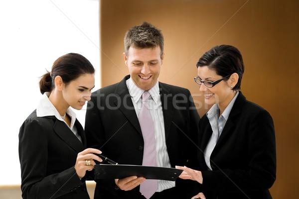 Uomini d'affari parlando bene abiti guardando file Foto d'archivio © nyul