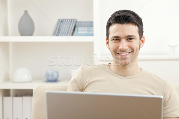 Man with laptop computer at home Stock photo © nyul