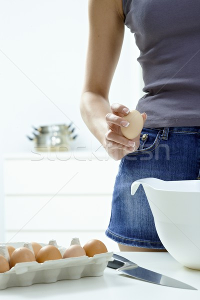 Breaking eggs Stock photo © nyul
