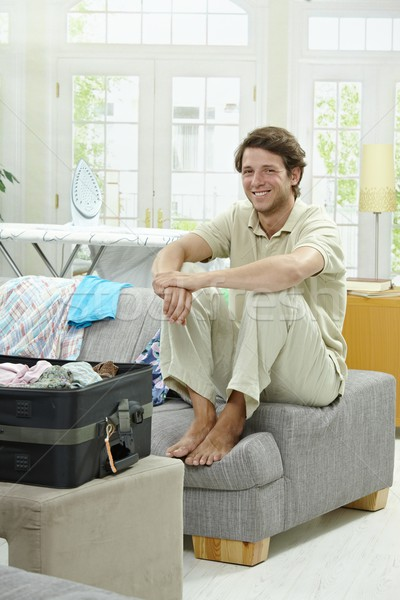 Young man packing for vacation Stock photo © nyul