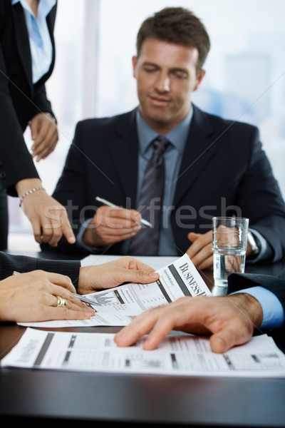 Businesspeople reviewing business report Stock photo © nyul