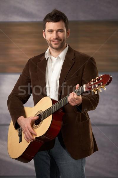 Adam gitar oynama ayakta moda elbise Stok fotoğraf © nyul