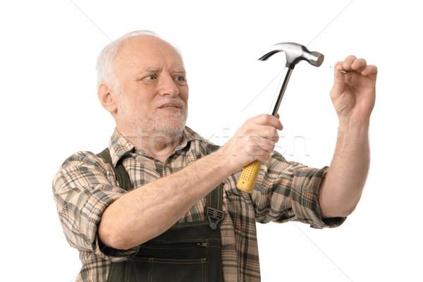 Senior man hammering Stock photo © nyul