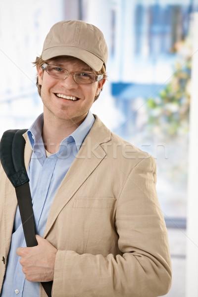 Fiatal üzletember iroda lezser visel baseballsapka Stock fotó © nyul