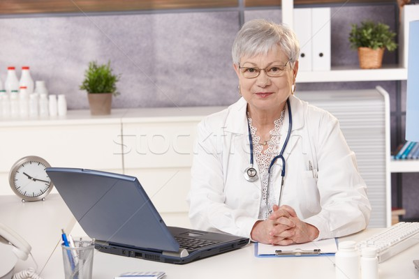 Portrait of senior doctor at work Stock photo © nyul