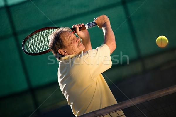 Senior man plays tennis Stock photo © nyul