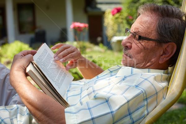 Senior man reading outdoor Stock photo © nyul