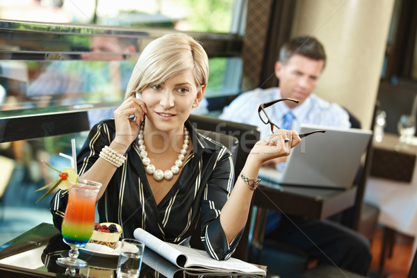 Businesswoman talking on mobile in cafe Stock photo © nyul