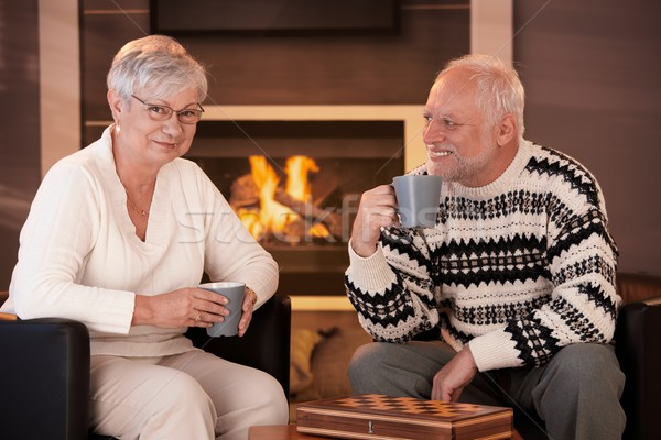 Happy senior couple on winter night at home Stock photo © nyul