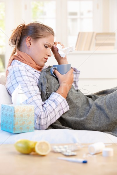 Young woman caught cold curing herself at home Stock photo © nyul