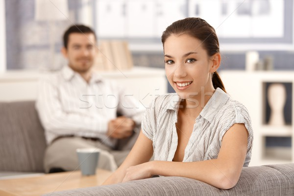 Young couple sitting in living room at home Stock photo © nyul