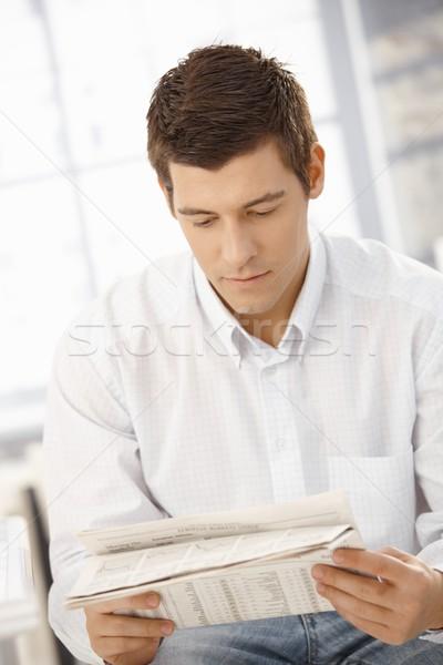 Young man reading newspaper Stock photo © nyul