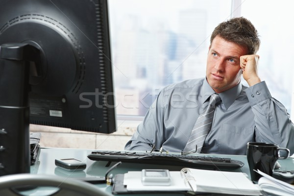 Businessman making decision in office Stock photo © nyul