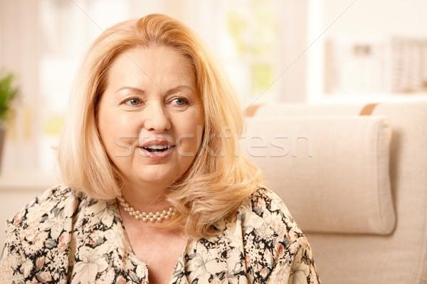 Stock photo: Portrait of senior woman talking