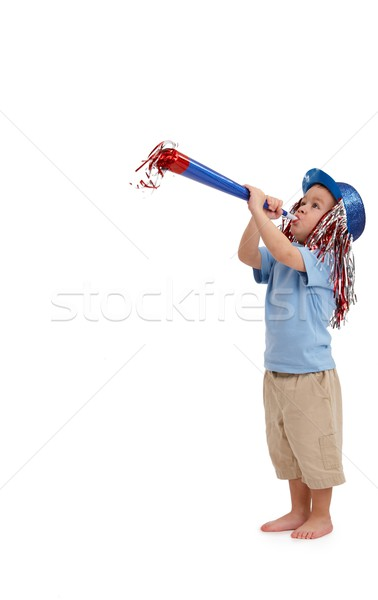 Happy little kid with party horn Stock photo © nyul