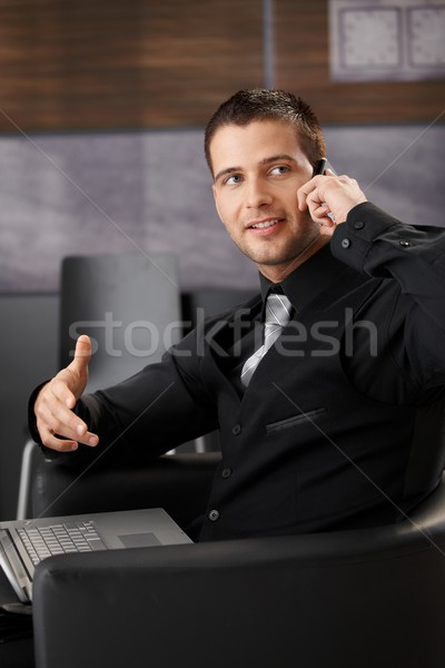 Goodlooking businessman chatting on phone Stock photo © nyul