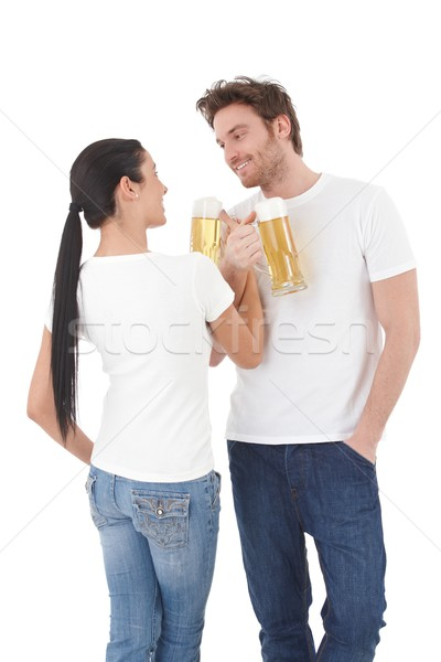 Young couple drinking beer having fun smiling Stock photo © nyul