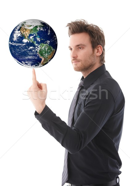 Goodlooking man balancing a globe on forefinger Stock photo © nyul