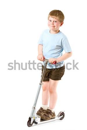 Kicsi fiú moped lovaglás mosolyog izolált Stock fotó © nyul