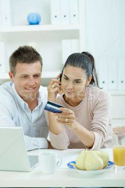 Pár vásárlás internet fiatal ül otthon Stock fotó © nyul