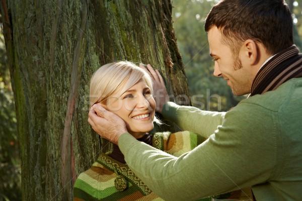 Portrait of happy couple in park Stock photo © nyul