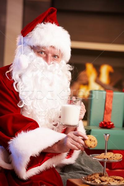 Stockfoto: Kerstman · melk · chocolade · chip · cookies · tevreden