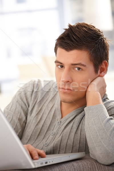 Handsome man with laptop Stock photo © nyul