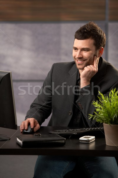 Stock photo: Smiling businessman with computer
