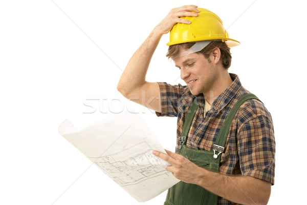 Young builder looking at floor plan Stock photo © nyul